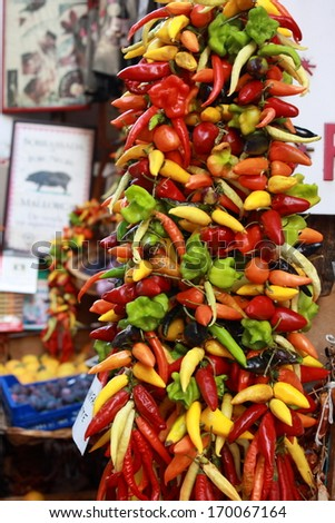 colourful chilli peppers on display at market - stock photo