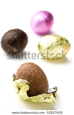 Colourful chocolate Easter eggs on white background
