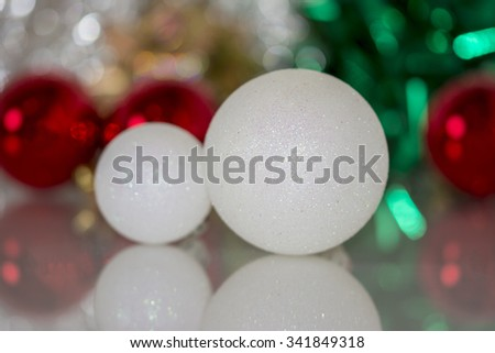 Colourful christmas baubles against a bokeh background