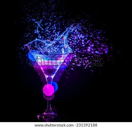 colourful cocktail on the black background. Party club entertainment. Mixed light - stock photo