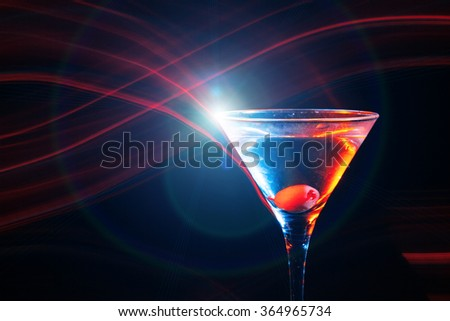 colourful cocktail with flares on the black background - stock photo