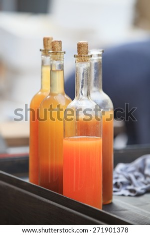 colourful drink in whine bottles with cork - stock photo