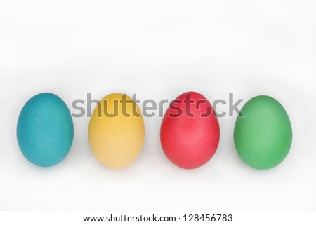 Colourful easter eggs standing in a line with copy-space