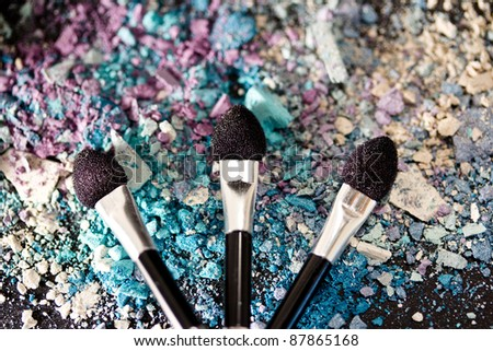 colourful eyeshadow powders and make-up brushes - stock photo