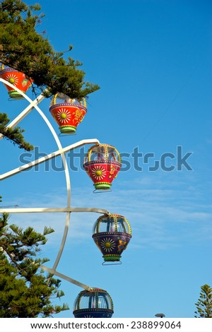 Colourful ferris wheel  - stock photo
