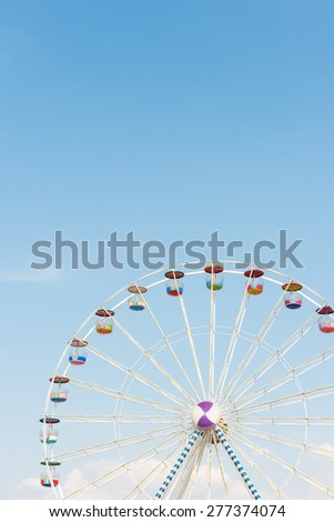 colourful ferris wheel with blue sky