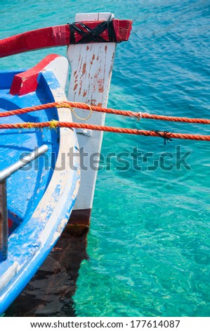 colourful fishing boat in turquoise waters