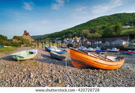 Colourful fishing boats on the shore at Porlock Weir a picturesque village on the Exmoor coast in Somerset - stock photo