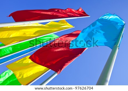 Colourful flags against the blue sky