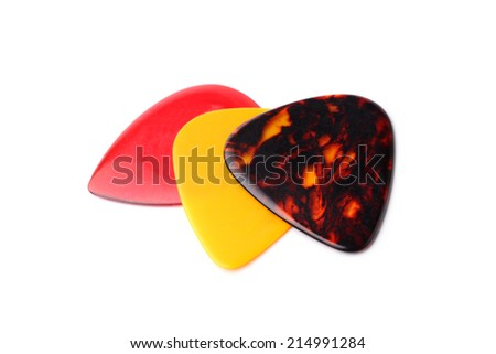 Colourful guitar plectrums on white background - stock photo