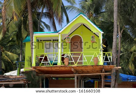 Colourful hats on sandy beach by the sea, Goa, India - stock photo