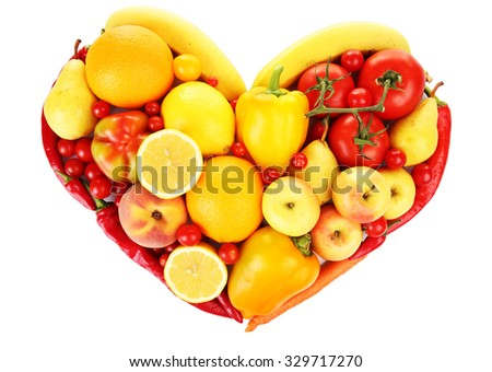 Colourful heart shaped fruit and vegetables composition isolated on white