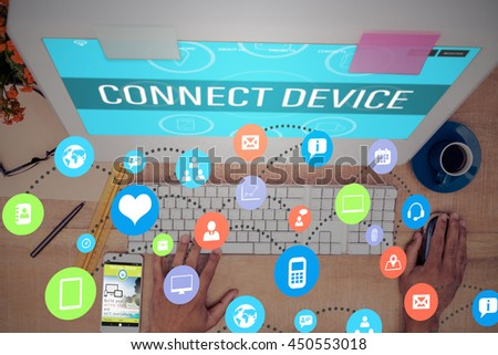 Colourful icons against high angle view of businessman working on computer - stock photo