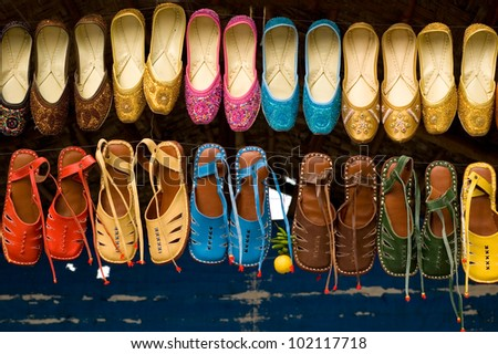 Colourful  indian slippers in the market - stock photo