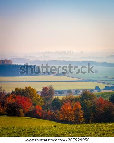 Colourful misty autumn landscape - stock photo