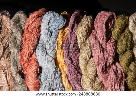 colourful of silk yarn dyed by nature colour, isolated on black background - stock photo
