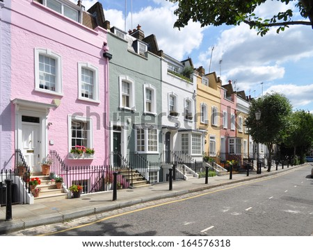 Colourful old terraced houses without parked cars, in London street. - stock photo
