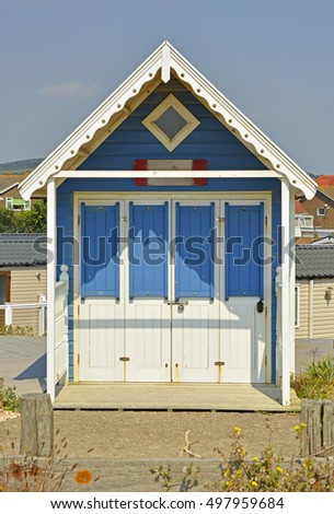 Colourful painted beach hut at Lancing (near Brighton) in West Sussex, England