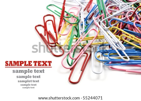 Colourful paper clips on a white background with space for text - stock photo