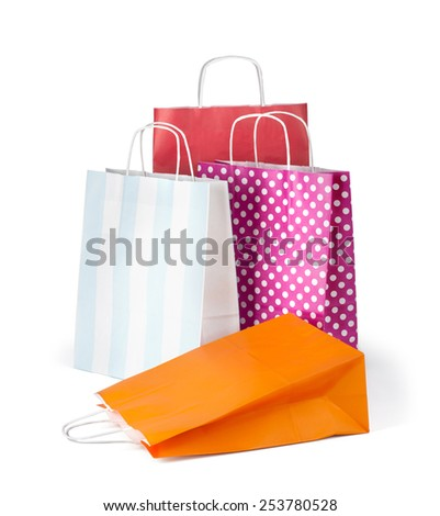 Colourful paper shopping bags isolated on white with clipping path