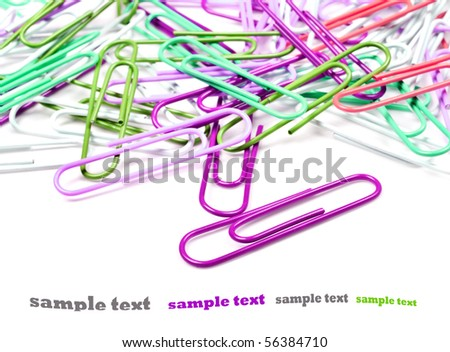 Colourful paperclips on a pure white background with space for text
