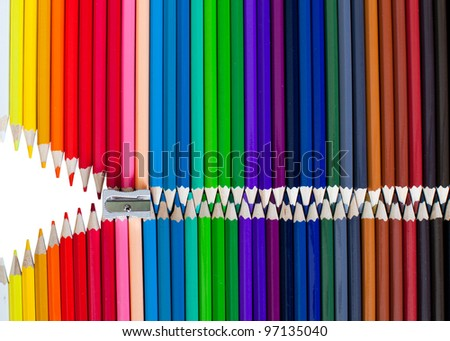 Colourful pencils being unzipped - stock photo