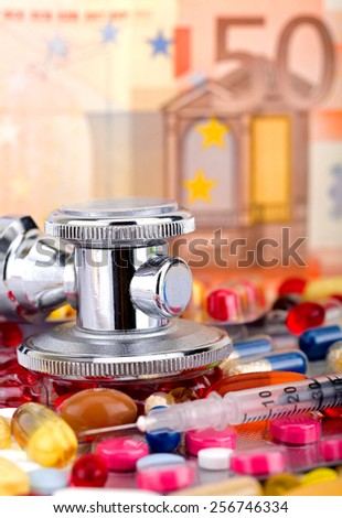 Colourful pills and capsules over 50 euro - stock photo