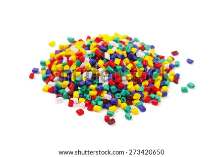 Colourful plastic granules on a white background
