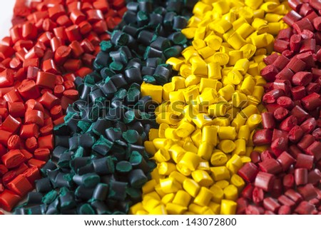 Colourful plastic polymer granules - stock photo