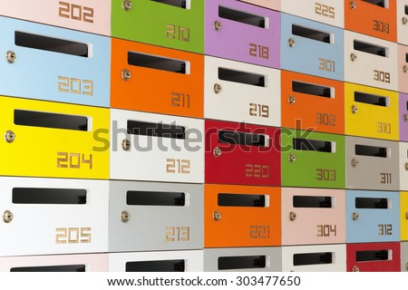 Colourful  post boxes. - stock photo