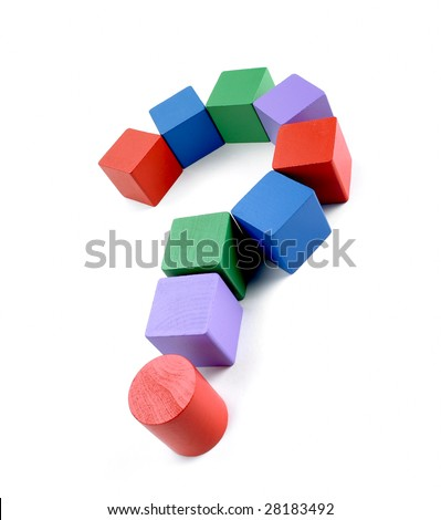Colourful question mark made out of children's old wooden building blocks