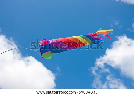 Colourful Rainbow Wind Spinner against Blue Sky