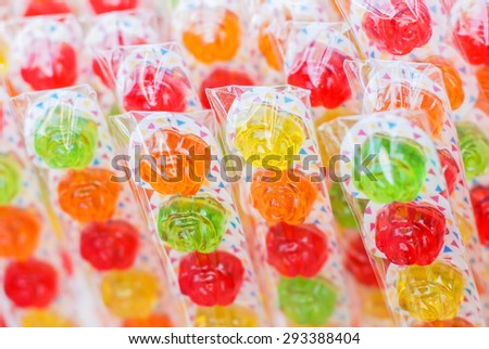 Colourful rose lollipop - stock photo