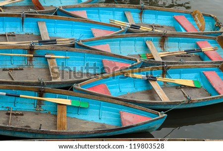 Colourful rowing boats tidily parked on the river Cherwell in Oxford - stock photo