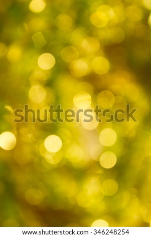 Colourful spark and blow colourful bokeh light in golden colour tone for abstract background