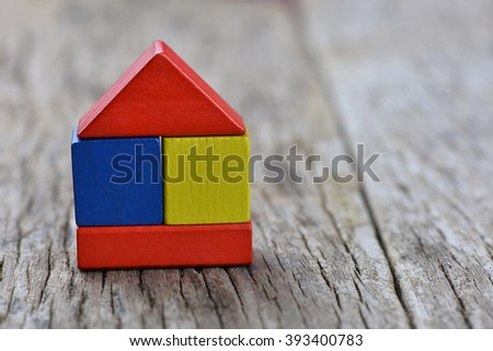 Colourful square stacked block on wooden background. Home conceptual