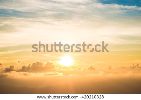 Colourful Sunrise beam with blue orange sky and cloud