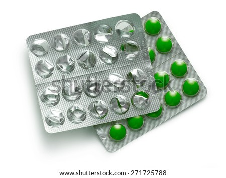 Colourful tablets in plastic packing on white - stock photo