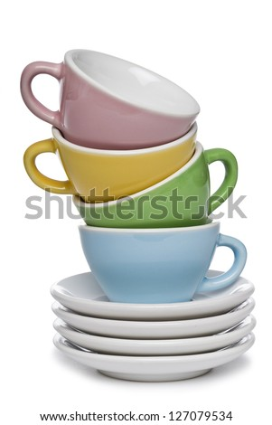 Colourful teacups stacked on a white background. Clipping path included