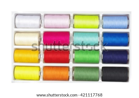 colourful threads in box on white background - stock photo