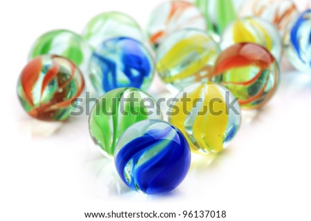 Colourful toy marbles on white background - stock photo