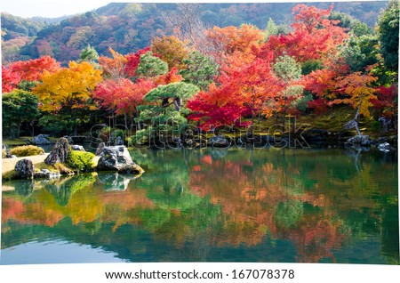 colourful trees with mirror lake in Autumn in Japan - stock photo