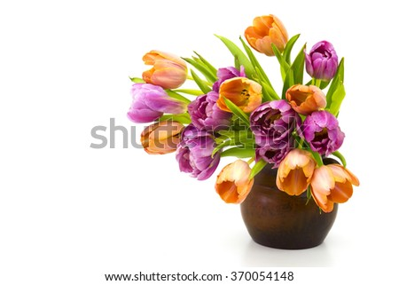 colourful tulips in a vase - stock photo