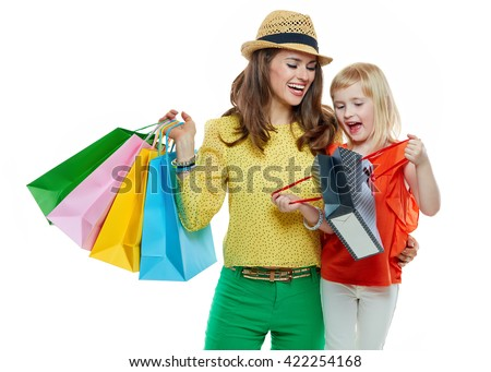 Colourful vibes of family shopping. Portrait of happy mother and daughter looking inside shopping bag on white background - stock photo