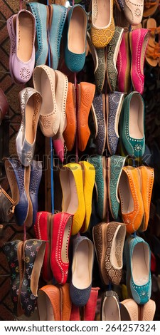 Colourful women leather shoes on display in a bazaar in the Medina of Marrakech, Morocco. - stock photo