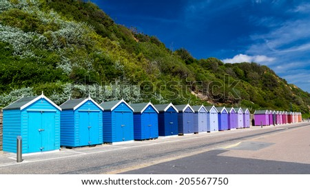 Colourful wooden beach huts at Bournemouth on the South Coast of England UK Europe - stock photo