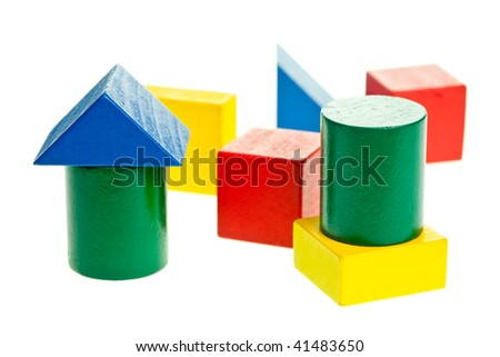 Colourful wooden children's blocks on white background, shallow dof - stock photo