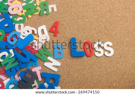 Colourful word loss with  cork board as background - stock photo
