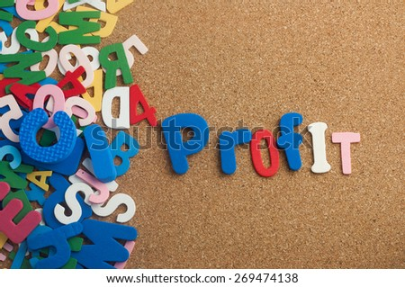 Colourful word Profit with  cork board as background - stock photo