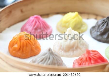 Colourful Xiao Long Bao - Shanghai style steamed pork dumplings - stock photo